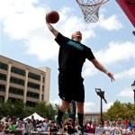 Постер, плакат: Man Leaps To Jam Basketball In Outdoor Slam Dunk Contest