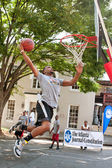 Man Attempts Slam Dunk During Outdoor Street Basketball Tournament — Stock Photo