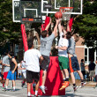 Men Jump While Fighting For Ball In Street Basketball Tournament — Stock Photo #31044371
