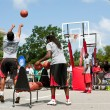 Stock Photo: Young MShoots Three Pointers In Outside Street Basketball Tournament
