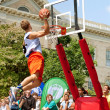 Stock Photo: Young MJumps High Above Rim In Outdoor Slam Dunk Contest