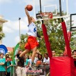 Stock Photo: Young MLeaps High In Outdoor Slam Dunk Contest