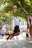 Young Man Leaps To Dunk Basketball During Outdoor Street Tournament — Stock Photo
