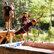 Stock Photo: People Dive Into Blood Pit On Zombie Obstacle Course Race