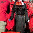 Stok fotoğraf: WomWearing Nun Costume Gets Fake Blood Splattered On Habit