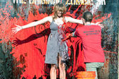 Female Zombie Gets Fake Blood Splattered On Her Dress — Stock Photo