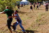 Female Zombie Nurse Chases Runner in Scary 5K Obstacle Race — Стоковое фото