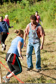 Male Zombie In Overalls Stalks Runners In Scary 5K Race — Stock Photo