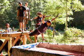People Dive Into Blood Pit On Zombie Obstacle Course Race — Stock Photo