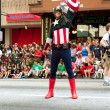 Постер, плакат: Captain America Salutes Spectators At Atlanta Dragon Con Parade