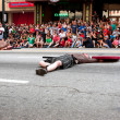 Stock Photo: Medieval Fighter Plays Dead On Street In Dragon Con Parade