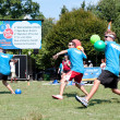 Постер, плакат: Three Men Throw In Unison At Outdoor Dodge Ball Game