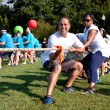 Stock Photo: Two Teams Pull Ropes In Adult Tug-Of-War Fundraiser
