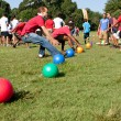Постер, плакат: Two Teams Sprint For Balls To Begin Dodge Ball Game