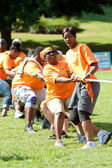 People Pull Rope In Team Tug-Of-War Competition — Stock Photo