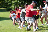Adults Pull Rope In Team Tug-Of-War Competition — Stock Photo