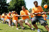Team Pulls Rope In Adult Tug-Of-War Competition — Stock Photo