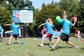 Three Men Throw In Unison At Outdoor Dodge Ball Game — Stock Photo