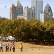 Stock fotografie: People Fly Kites In Park Against AtlantCity Skyline