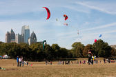 Composite Of Multiple Kites Flying Set Against City Skyline — Stock Photo