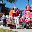 Stock Photo: Senior Citizens Square Dance At Outdoor Event