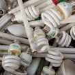 Stock Photo: Discarded Light Bulbs Fill Box At Recycling Event