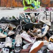 Stock Photo: Teen Volunteers Sort Through Sneakers At Recycling Event
