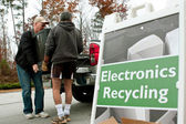Men Carry TV To Drop Off At Recycling Event — Stock Photo