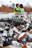 Teen Volunteers Sort Through Sneakers At Recycling Event — Stock Photo
