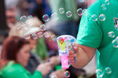 Man Makes Bubbles With Bubble Pistol At Parade — Stock Photo