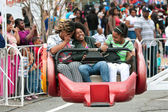 Women Laugh While Riding Carnival Ride — Stock Photo