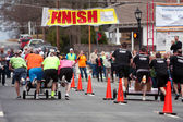 Two Teams Race Beds To Finish Line In Fundraiser — Stock Photo