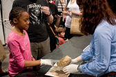 Girl Grimaces Touching Human Brain At Science Expo — Stock Photo