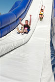 Couple Goes Down Giant Slide In Obstacle Race Challenge — Stock Photo