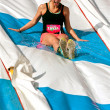 Постер, плакат: Young Woman Enjoys Going Down Slide In Obstacle Race