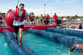 Man Runs Through Wrecking Balls At Crazy Obstacle Race — Stock Photo