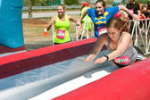 Women Dive Onto Wet Slide At Crazy Obstacle Race — Stock Photo