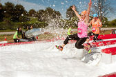 Women Get Sprayed With Bubbles Jumping Into Foam Pit — Stock Photo