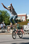 Young Man Stands On Bike Handlebars Practicing For BMX Competition — Stock Photo