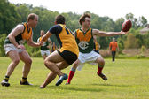 Player Reaches To Catch Ball In Australian Rules Football Game — Stock Photo