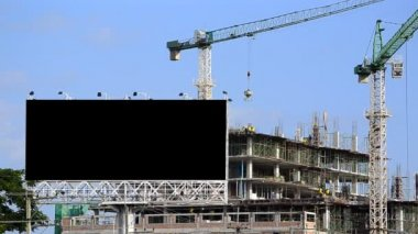 Construction site and big billboard — Stock Video