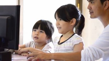 Asian Father And Cute Daughters Playing Computer — Stock Video