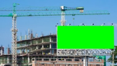 Time lapse construction site and big billboard green color — Stock Video