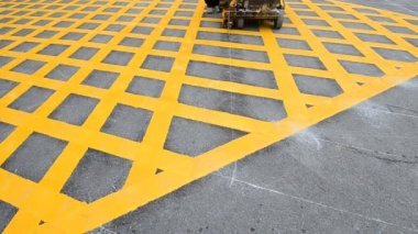 Labor use small machine paint line on road — Video Stock