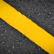 New yellow line on road texture — Stock Photo #36743335