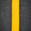 New yellow line on road texture — Stock Photo #36743371