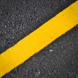 New yellow line on road texture — Stock Photo #36743447