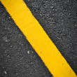 New yellow line on road texture — Stock Photo #36743491