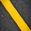 Stock Photo: New yellow line on road texture