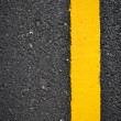 New yellow line on road texture — Stock Photo #36743591